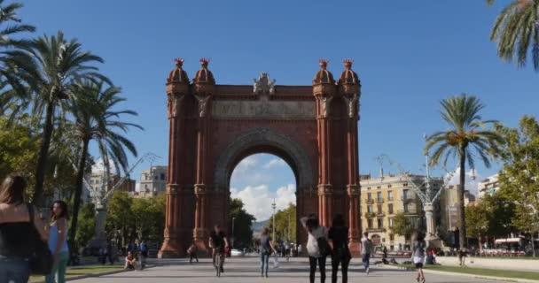 Tourists visit the Arc de Triomf in Barcelona.