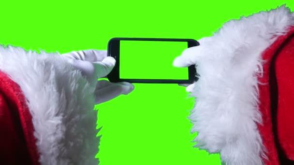 Santa Claus pomocí zelená obrazovka smartphone