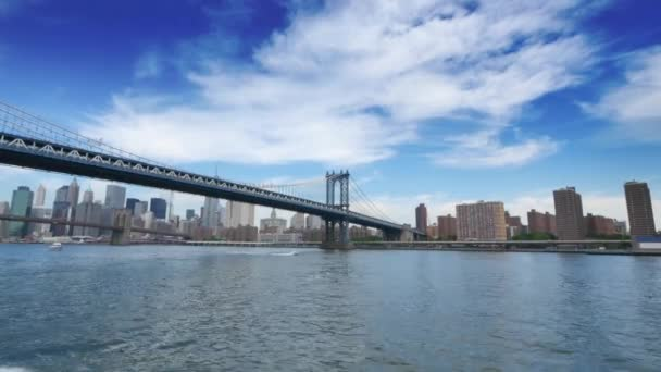A wide shot of the Manhattan Bridge with skyline of lower Manhattan in the distance.