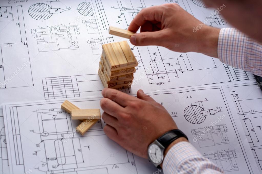 man architect draws a plan graph design geometric shapes by