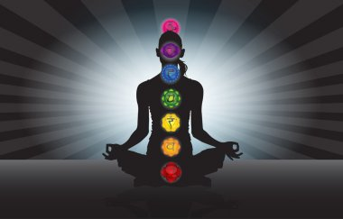 woman silhouette with seven chakra symbol