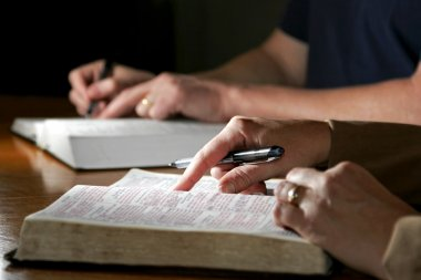 Man and Woman with Holy Bibles