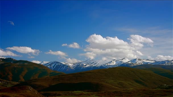 Cloudy sky over mountain peaks