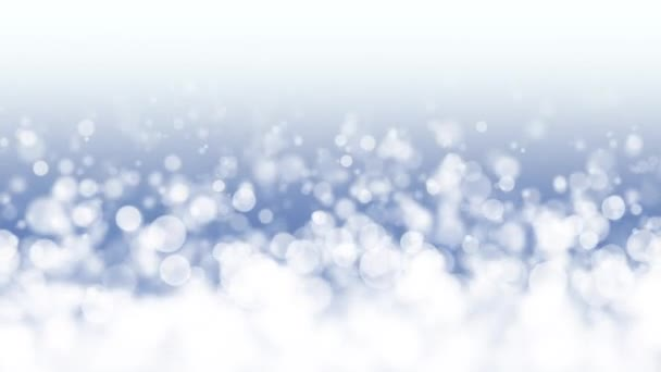 bílé částice padající pomalu