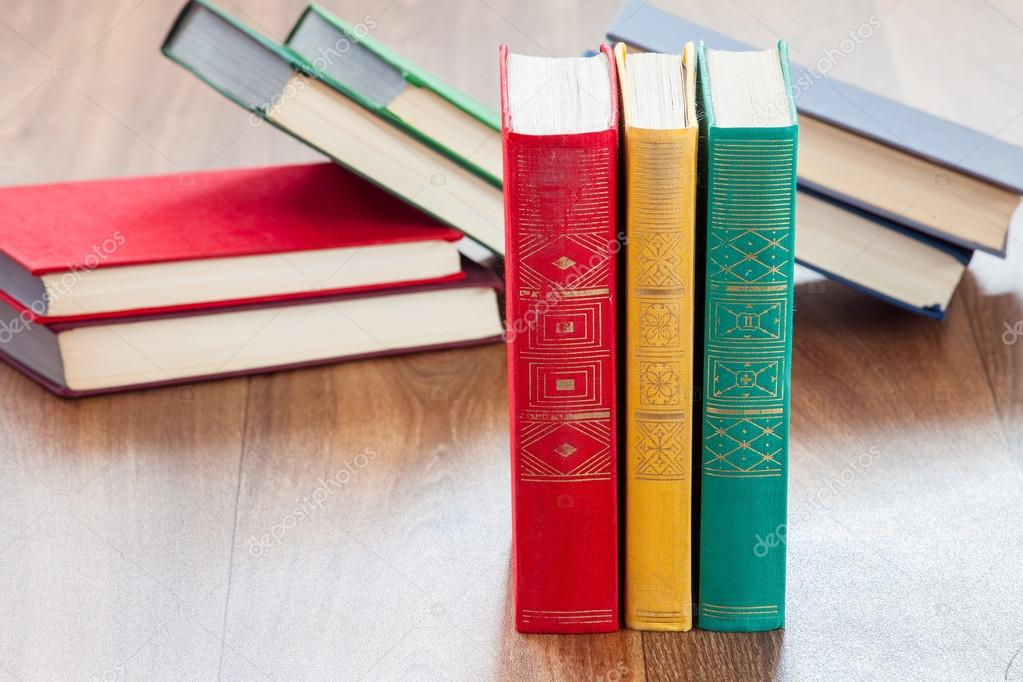the lying multi-colored books on a wooden table. — Stock Photo ...