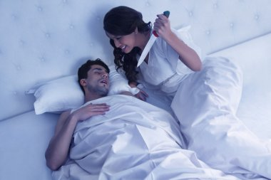 Woman about to stab sleeping husband