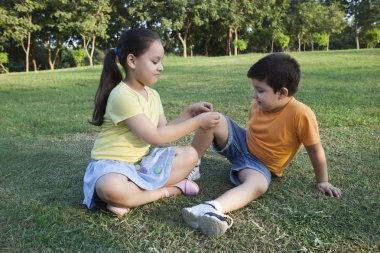 Girl putting band-aid