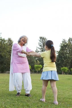 Happy Grandmother and granddaughter playing