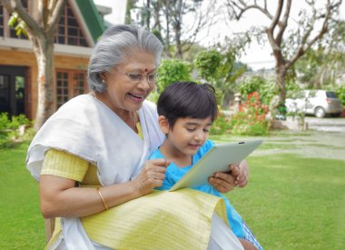 Grandmother and grandson with digital tablet