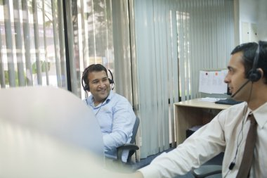 Executives with headsets working