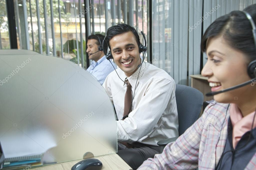 Executives smiling in office