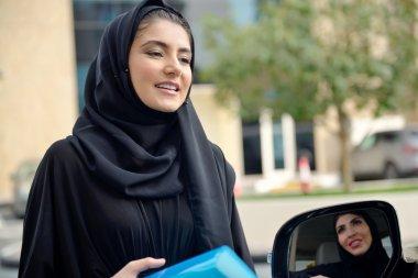 Emarati Arab Business women getting into the car