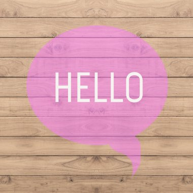 Hello greeting on pink quite wood background