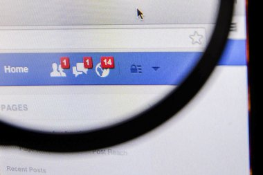 THAILAND - SEPTEMBER 2, 2014: Magnifying glass of Facebook page