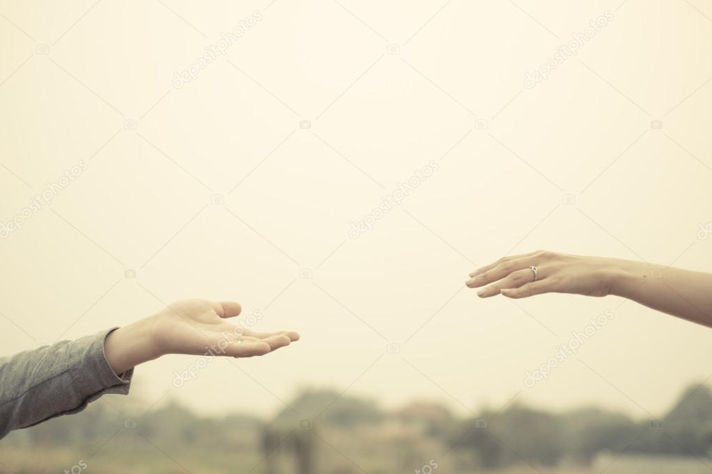 Couple hand together touch with love vintage filter tone.