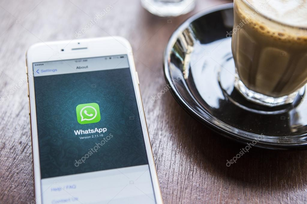 CHIANG MAI, THAILAND - APRIL 22, 2015:  iPhone 6 with social Internet service WhatsApp on the screen in coffee shop. iPhone 6 was created and developed by the Apple inc.