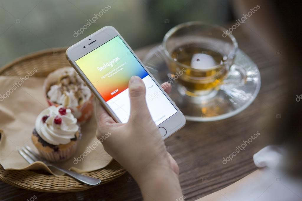 CHIANG MAI, THAILAND - JUNE 28, 2015: Woman trying to log in Instagram application using Apple iPhone 6. Instagram is largest and most popular photograph social networking site in the world.
