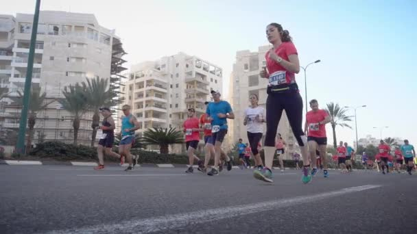 Marathon runners from low angle view