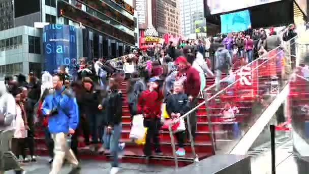 people on stairs of Times Square in New York