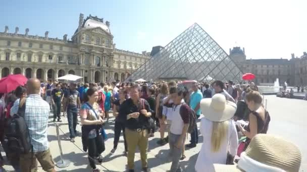 People outside the Louvre museum on a summer day