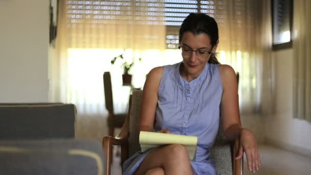 Psychotherapist  taking notes at a session