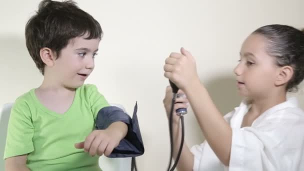 Kids play doctor and measure blood pressure