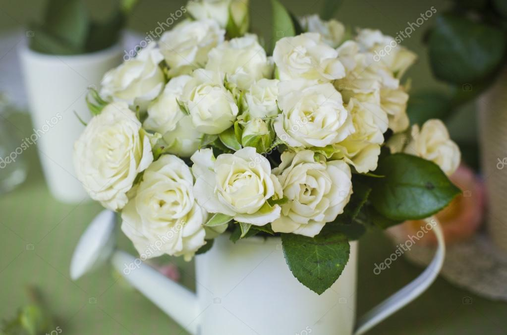 Bouquet Of White Roses In A White Vase On A Green Background