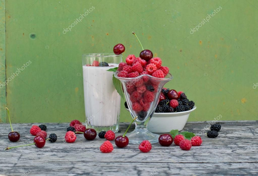 Raspberry, cherry and mulberry on a green background