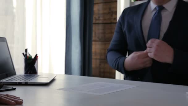 Businessman reading contract and signing it afterwards. Successful deal and handshake