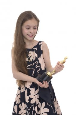 Girl Looking at Trophy