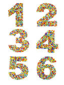Photo Numbers 1 through 6 made from colorful glass beads on a white