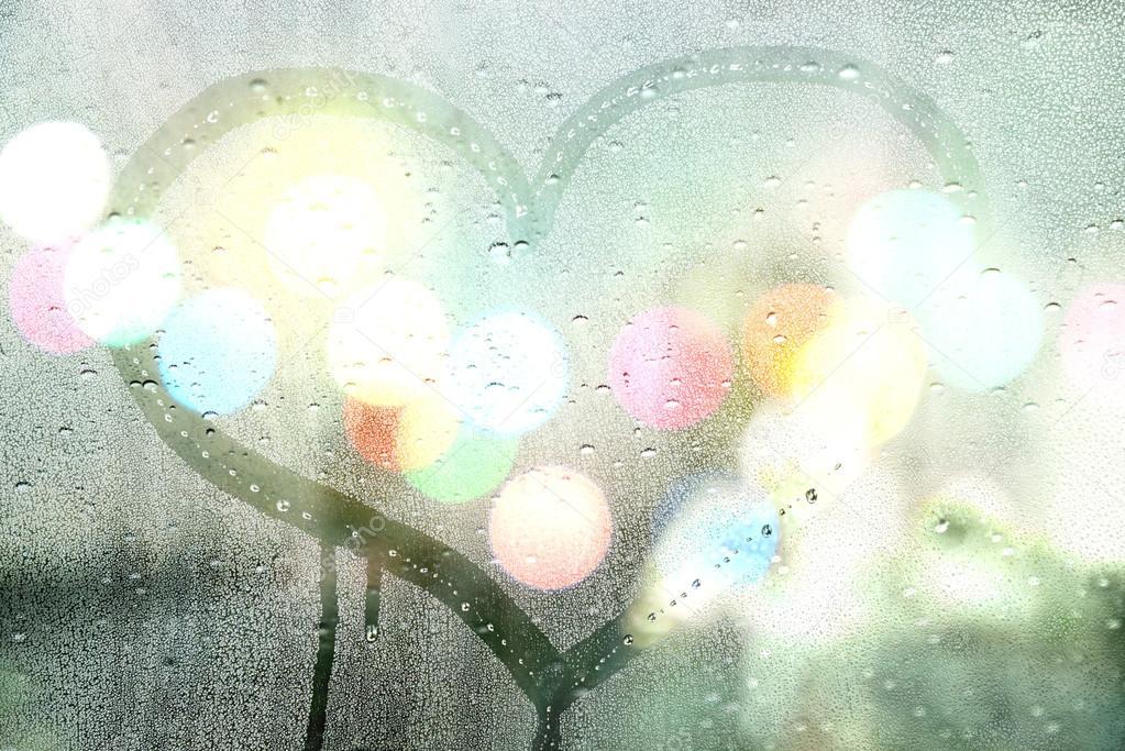 Autumn rain, draw heart on glass - love concept