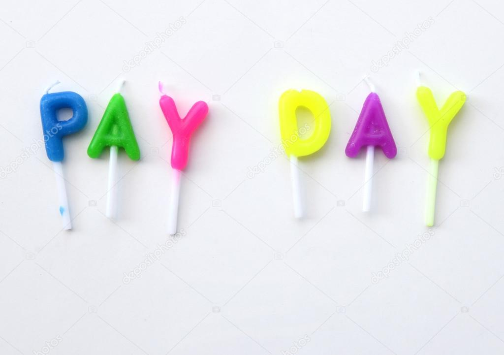 candle made of word pay day financial concept stock photo