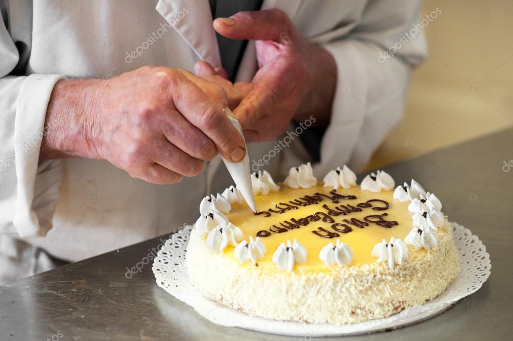 Strange Baker Writing Birthday Message On Top Of Cake Stock Photo Funny Birthday Cards Online Eattedamsfinfo