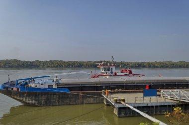 River cargo boat at pontoon in Ruse Danube port