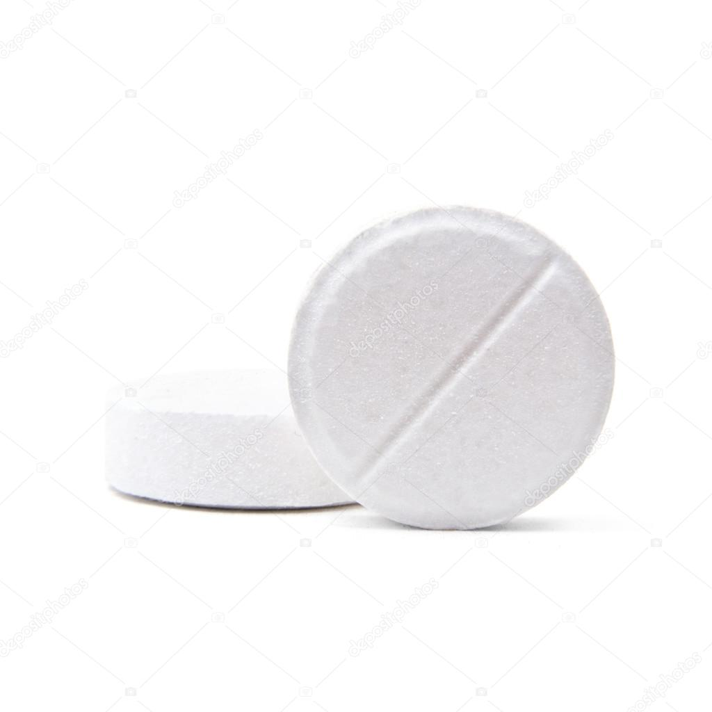 Macro shot of two medical round pills isolated on white — Stock Photo