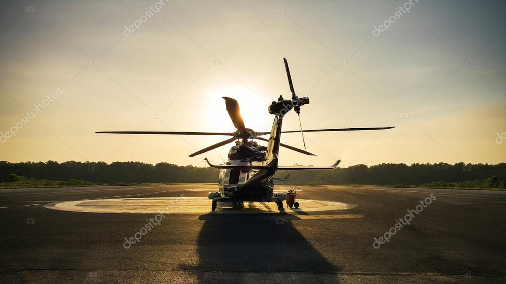 helicopter parking landing on offshore platform, Helicopter transfer crews or passenger to work in offshore oil and gas industry, air transportation for support passenger, ground service.