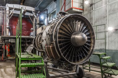 Airplane gas turbine engine detail in hangar