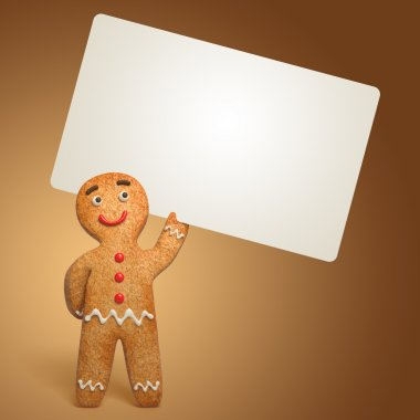 Gingerbread man holding white card