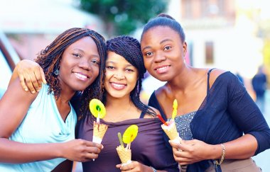 portrait of happy african friends with ice cream