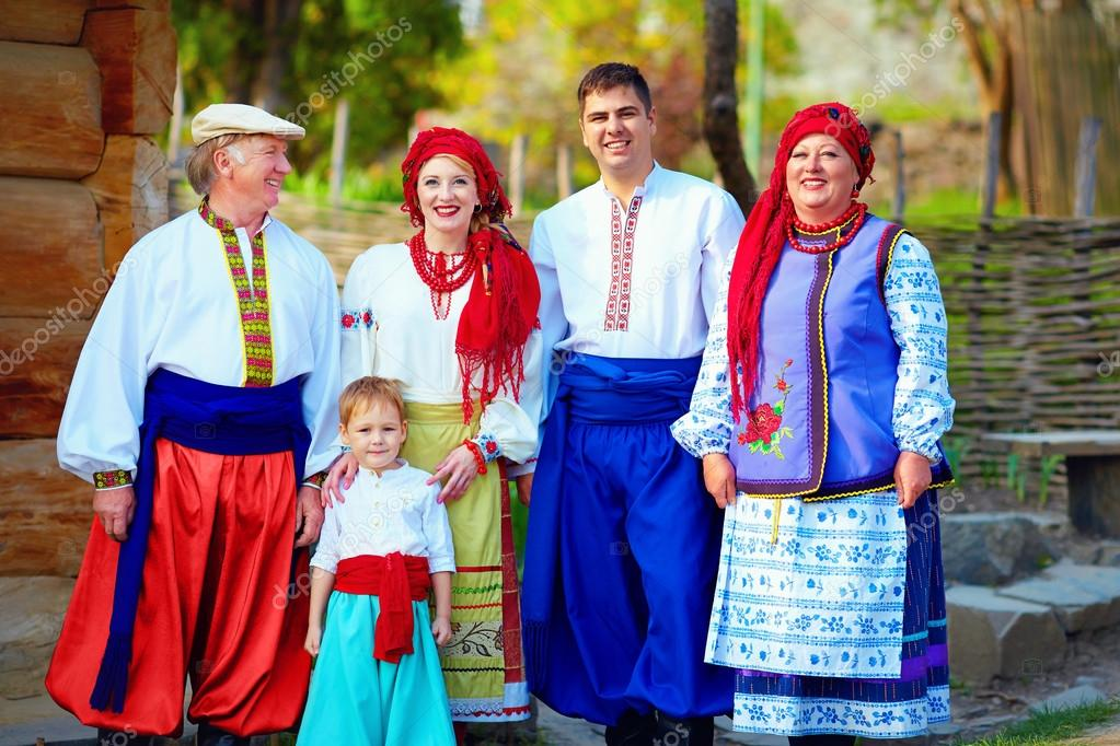 portrait of happy ukrainian family in traditional costumes