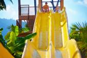 happy father and son are ready to slide in tropical aqua park