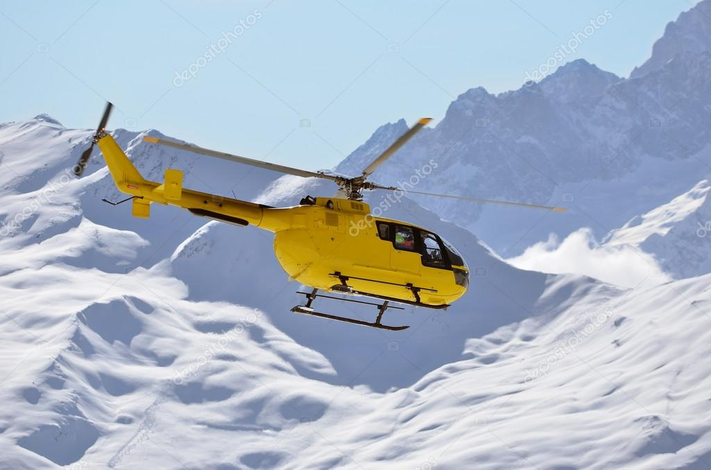 a rescue helicopter in snow covered mountains