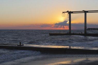 Beautiful sunset on the beach of the resort settlement Adler