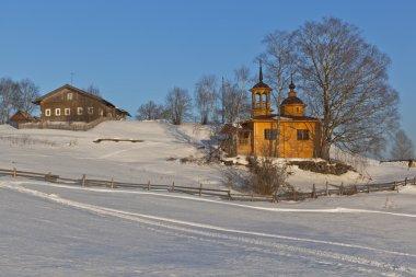 Wintry rural landscape with chapel. Chapel of the Assumption Mother of God in a village Markovskaya Verkhovazhsky District Vologda Region, Russia