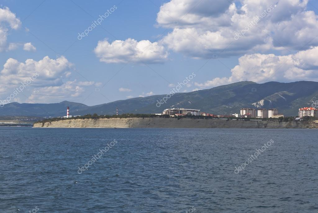 View from the open sea on cliff Cape Tolstoy and resort town Gelendzhik, Krasnodar region, Russia