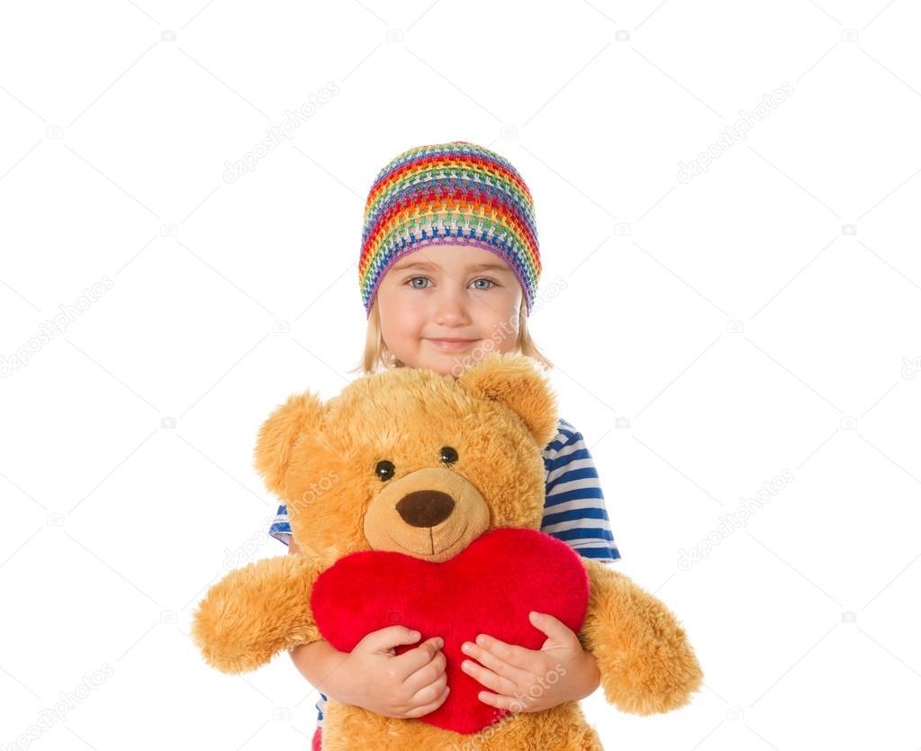 Little girl holding Teddy bear and heart.