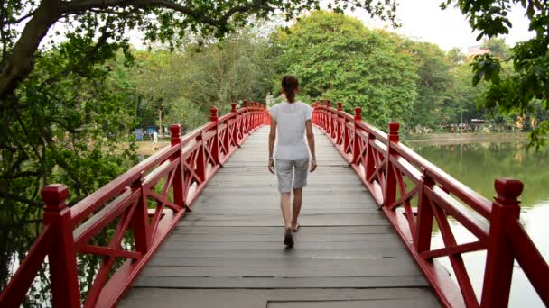 Woman Walking over The Huc Bridge