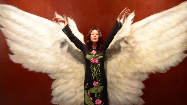 Asijské ženy s Angel Wings