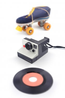 Old instant camera with roller skate and vinyl - eighties